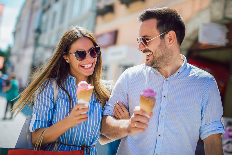 happy couple eating ice cream, smiling